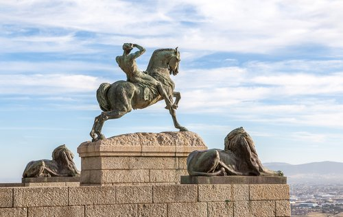 The Rhodes memorial Statue.  A man riding a horse. At this memorial families can enjoy playgrounds and good food