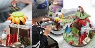 A table full of arts and crafts that kids get to make during the make it magical workshops.  They look like bright colourful fairy houses that the kids made.